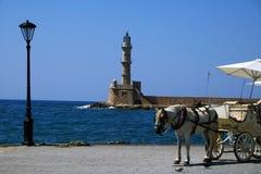 Faro de Chania y carro traído por caballo Imagen de archivo