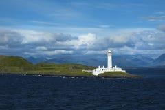 Faro de Eilean Musdile cerca de Oban en Escocia Fotos de archivo
