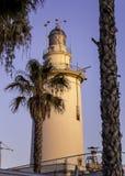 Faro de Málaga. Photography of a sunset in Málaga port with view of lighthouse Faro de Málaga Stock Photography