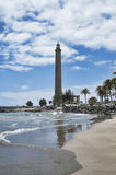 Faro de Maspalomas, Gran Canaria, Spain. Vertical shot of large, beautiful beach, on a partially cloudy day, in front of Faro de Maspalomas or Maspalomas stock photos