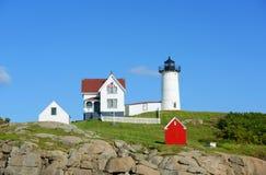 Faro de Neddick del cabo, pueblo viejo de York, Maine Imagen de archivo