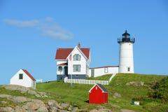 Faro de Neddick del cabo, pueblo viejo de York, Maine Imagenes de archivo