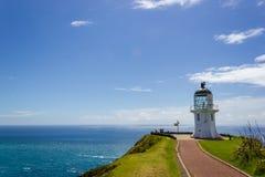 Faro de Reinga del cabo, borde del norte de Nueva Zelanda foto de archivo