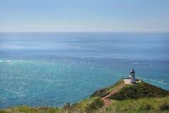 Faro de Reinga del cabo, Nueva Zelanda Foto de archivo