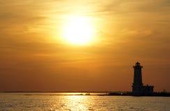 Faro del albino de la punta en la puesta del sol Imagen de archivo libre de regalías