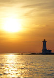 Faro del albino de la punta en la puesta del sol fotografía de archivo libre de regalías