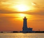 Faro del albino de la punta en la puesta del sol Fotografía de archivo