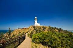Faro della baia di Byron proiettato in cielo blu Fotografie Stock