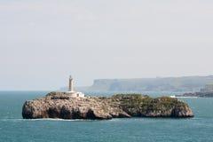 Faro dentro ed isola Fotografie Stock