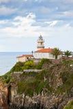 Faro di Cudillero, Asturie, Spagna del Nord Immagini Stock Libere da Diritti