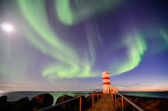 Faro di Gardur, aurora borealis, luna, Islanda Immagine Stock Libera da Diritti
