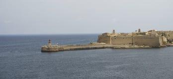 Faro di La Valletta della La e la fortificazione immagine stock libera da diritti