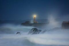 Faro di Mouro a Santander alla notte Fotografia Stock