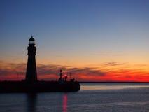 Faro di tramonto Fotografia Stock