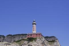 Faro e isla fotografía de archivo libre de regalías