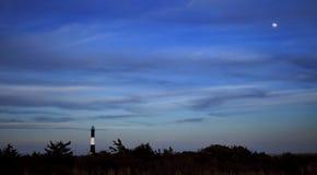 Faro e la luna Fotografie Stock Libere da Diritti