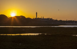 Faro e porticciolo di EL Rompido ad alba dalle regioni paludose Immagine Stock Libera da Diritti