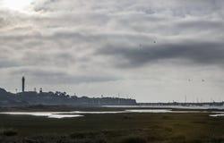 Faro e porticciolo di EL Rompido ad alba dalle regioni paludose Fotografia Stock