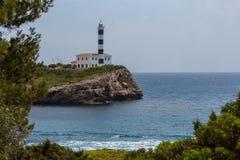 Faro en aguas inmóviles Imagen de archivo libre de regalías