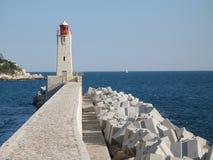 Faro en el acceso de Niza Fotos de archivo