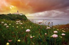 Faro en el amanecer Imagen de archivo libre de regalías