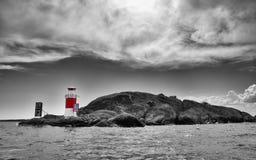 Faro en el archipiélago sueco Foto de archivo libre de regalías
