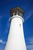Faro en el cielo azul Foto de archivo libre de regalías