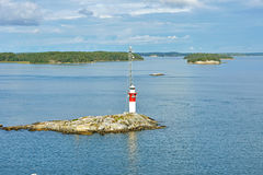 Faro en el mar Báltico foto de archivo