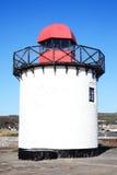 Faro en el puerto Burry Imagenes de archivo