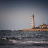 Faro en la costa imágenes de archivo libres de regalías