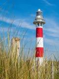 Faro en la costa del Mar del Norte Foto de archivo libre de regalías