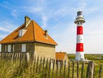 Faro en la costa del Mar del Norte Imágenes de archivo libres de regalías