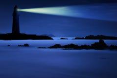 Faro en la noche Imagen de archivo libre de regalías