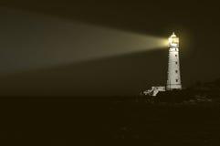 Faro en la noche Imagenes de archivo