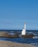 Faro en la playa Foto de archivo libre de regalías