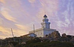 Faro en la puesta del sol Fotografía de archivo