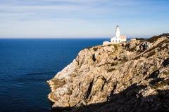 Faro en la roca Fotografía de archivo libre de regalías