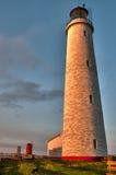 Faro en la salida del sol fotografía de archivo