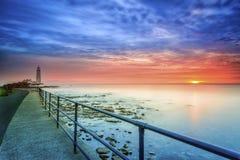 Faro en la salida del sol Imágenes de archivo libres de regalías
