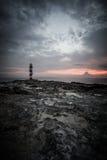 Faro en la salida del sol Fotografía de archivo libre de regalías