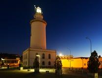 Faro en Málaga en noche Imagenes de archivo