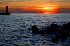 Faro en salida del sol Foto de archivo
