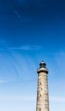 Faro en Skagen con la gran formación del cielo Fotografía de archivo libre de regalías