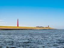 Faro Lange Jaap alla costa del Mare del Nord, Huisduinen, Den Helder, Paesi Bassi fotografia stock