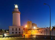 Faro a Malaga nella sera fotografie stock libere da diritti