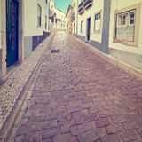 Faro. Narrow Street in the Medieval Portuguese City of Faro, Instagram Effect Royalty Free Stock Photography