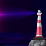 Faro nella notte con un raggio Immagini Stock