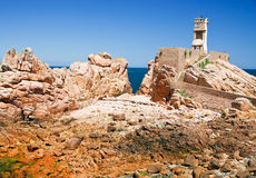 Faro nelle rocce Fotografie Stock