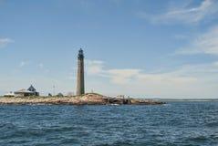 Faro pequeno de Manan una guía a los marinos Fotografía de archivo