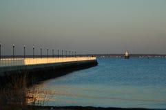 Faro plano del ` s de Butler en la puesta del sol Fotos de archivo libres de regalías